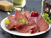 Slices of salami on plate