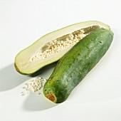 Halved green papaya