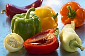 Various types of peppers, whole and halves
