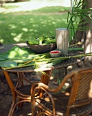 Rattan furniture with banana leaves & bamboo out of doors