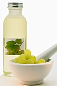 White grapes in a mortar and white grape seed oil