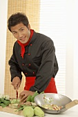 Asian chef preparing vegetables for stir-fry
