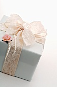 Gift in white wrapping paper with bow