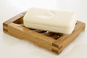Yoghurt soap on wooden soap dish