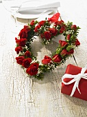 Heart-shape wreath of roses and baby's breath