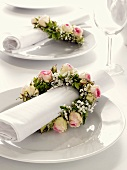 Napkin wreaths of roses and baby's breath