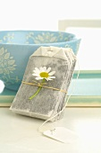 Tea bag with chamomile flower and tea bowl