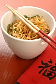 Asian noodle dish with chopsticks
