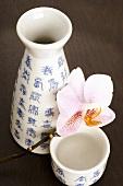 Sake flask (choshi) and cup (sakazuki) with orchid