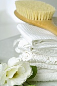 Towels and massage brush with lisianthus flowers
