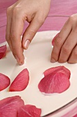 Hand spa with rose petals