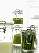 Green beans and sauces in preserving jars