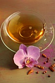 Tea with dried chillies and orchid flower