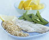 Fillet of plaice with brown rice and sugar snap peas