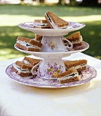 Sandwiches on tiered stand made with upturned cups