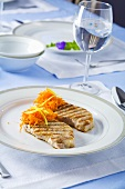 Grilled pork loin chops with grated carrots