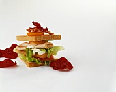 A club sandwich and beetroot chips