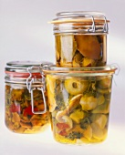 Pickled vegetables in three jars