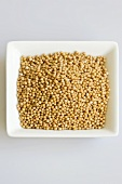 Mustard seeds in small white dish