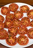 Fried tomato halves on a plate