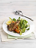 Lamb chop with carrots and salad