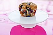 Blueberry Muffin with Colorful Wrapper on Pedestal Dish
