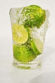 Limes in a glass of water