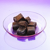 Black Currant Truffle Squares in a Glass Dish