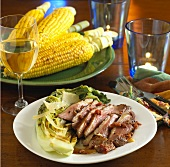 Sliced Grilled Duck Breast with Romain; White Wine and Corn on the Cobb