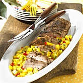 Partially Sliced Grilled Pork Loin with Mango Salsa; On Platter