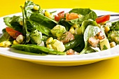 Spinach and sweetcorn salad with tomatoes, cucumber and dill