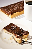 Piece of Chocolate Hazelnut Tart with Shortbread Crust; Fork; Espresso