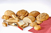 A variety of breads and rolls with butter