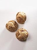 Three sesame seed rolls