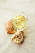 Glass of White Wine with Crusty Roll