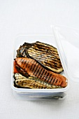 Grilled vegetables in a plastic box