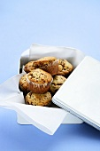 Chocolate chip muffins in a picnic tin