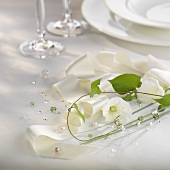 Elegant table decoration with white bow and flowers