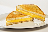 Grilled Cheese Sandwich with Orange Cheese; Halved and Stacked