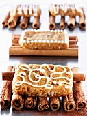 French 'pepper nut' biscuits on cinnamon sticks