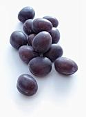 Several fresh plums