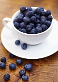Fresh Blueberries in a White Coffee Cup