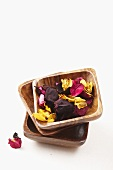 Dried rose petals in wooden bowls