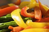 Sliced Yellow and Orange Bell Peppers with Asparagus