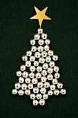 A sliver Christmas tree made of sugar balls