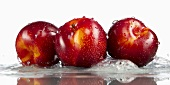 Three plums in water