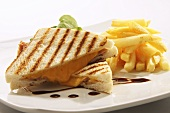 Toasted cheese and ham sandwich with chips