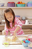 A girl kneading shortbread