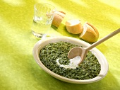 Spinach with sour cream, baguette and a glass of water