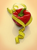 A red pepper with a tape measure